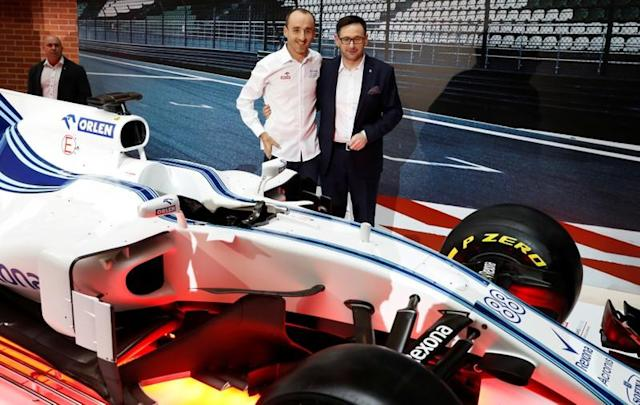FILE PHOTO: Williams driver Kubica and PKN Orlen CEO Obajtek pose during a news conference on PKN Orlen cooperation in the Formula One in Warsaw