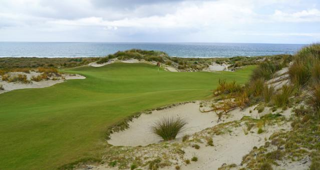"""<div class=""""caption""""> A view of the sixth green while standing on the walkway to the seventh tee </div>"""
