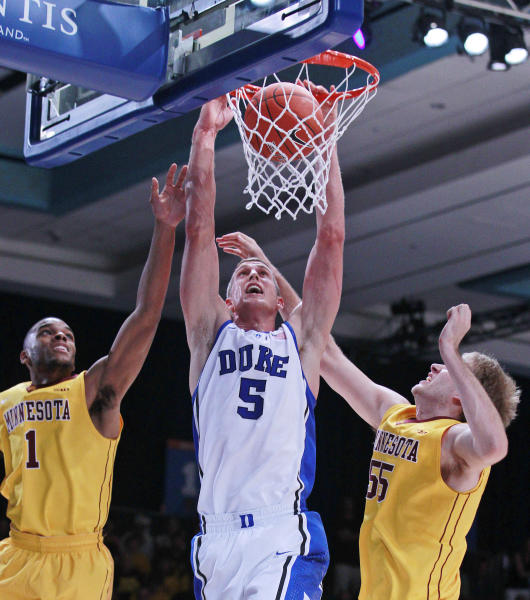 Duke forward Mason Plumlee (5) scores as Minnesota's Andre Hollins (1) and Elliott Eliason (55) defend during the first half of an NCAA college basketball game at the Battle 4 Atlantis tournament, Thursday, Nov. 22, 2012, in Paradise Island, Bahamas. (AP Photo/John Bazemore)