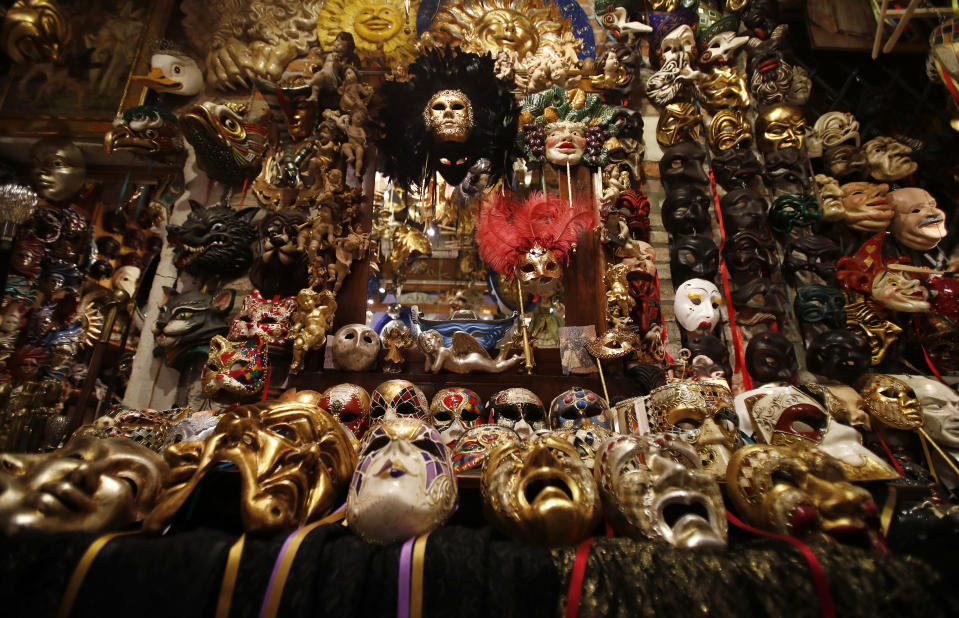 Carnival masks are laid out on display in Venetian artisan mask maker Gualtiero Dall'Osto's workshop in Venice, Italy, Saturday, Jan. 30, 2021. (AP Photo/Antonio Calanni)