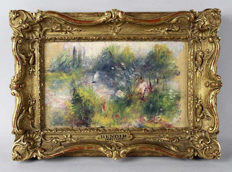 """This undated image provided by the Potomack Company shows an apparently original painting by French impressionist Pierre-Auguste Renoir that was acquired by a woman from Virginia who stopped at a flea market in West Virginia and paid $7 for a box of trinkets that included the painting. An auction house has put on hold the sale of a painting believed to be by French impressionist Pierre-Auguste Renoir that a woman bought at a West Virginia flea market because a reporter found evidence someone stole the painting from the Baltimore Museum of Art. A Washington Post reporter discovered documents in the museum's library showing the painting was there from 1937 until 1949. Museum officials then found paperwork showing the painting, """"Paysage Bords de Seine,"""" was stolen in 1951. (AP Photo/Potomack Company)"""