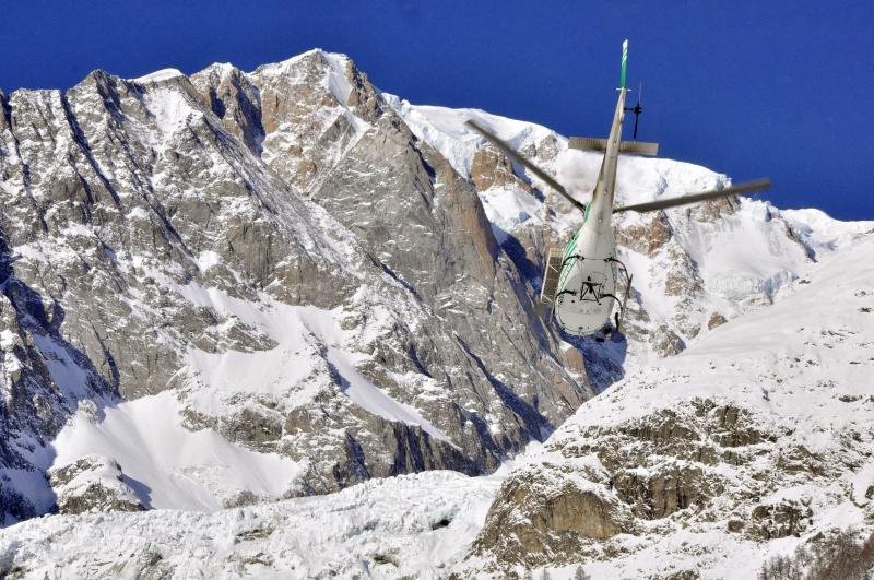 An helicopter of the Valdostano Alpine Rescue corp leaves an helipad in Aosta, Italy, Monday, Feb. 4, 2019, to reach the spot where the bodies of three skiers where found. Rescuers have found the bodies of three skiers in Italy's Alps and are searching for a fourth, raising the death toll in recent avalanches in the country to at least five. The Valdostano Alpine Rescue aircraft on Monday, searching for two British and two French skiers who were reported missing a day earlier, spotted three bodies. Dogs were helping in the search. (Thierry Pronesti/ANSA Via AP)