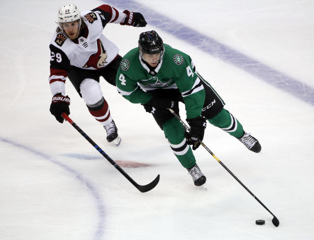 Arizona Coyotes right wing Mario Kempe (29) chases Dallas Stars defenseman Miro Heiskanen (4) during the third period of an NHL hockey game in Dallas, Thursday, Oct. 4, 2018. The Stars defeated the Coyotes 3-0. (AP Photo/Michael Ainsworth)