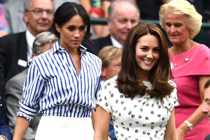 The Duchess of Sussex and Duchess of Cambridge attend day 12 of the Wimbledon Lawn Tennis Championships on July 14, 2018, in London. (Photo: Clive Mason via Getty Images)