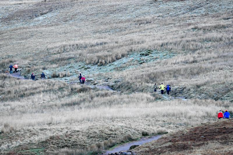 Walkers braving the cold on Pen y Fan mountain in the Brecon Beacons National Park yesterday (PA)