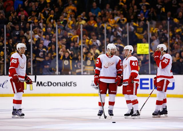BOSTON, MA - APRIL 26: Members of the Detroit Red Wings including Kyle Quincey #27 and Luke Glendening #41 stand together after giving up a goal in the second period against the Boston Bruins in Game Five of the First Round of the 2014 NHL Stanley Cup Playoffs at TD Garden on April 26, 2014 in Boston, Massachusetts. (Photo by Jared Wickerham) (Photo by Jared Wickerham/Getty Images)