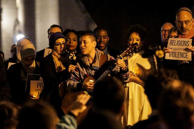 <p>A woman sings during a candlelight vigil for victims of the pickup truck attack at Foley Square in New York City, Nov. 1, 2017. (Photo: Jeenah Moon/Reuters) </p>