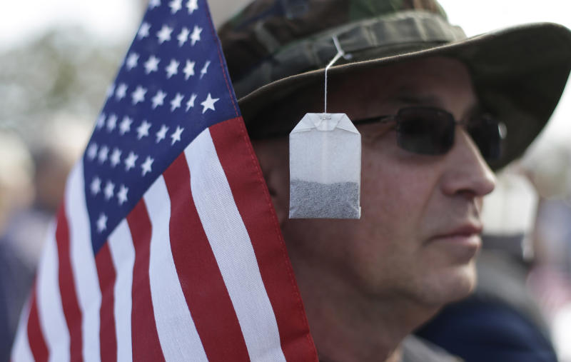 Tea bags hang from the hat of Steve Wandtke during a Guns Across America rally at the state capitol, Saturday, Jan. 19, 2013, in Austin. Texas officials opposed to new federal gun control proposals plan to speak on the steps of the state Capitol during a pro-Second Amendment rally. The event is one of many rallies planned across the country Saturday. They come four days after President Barack Obama unveiled a sweeping plan to curb gun violence.  (AP Photo/Eric Gay)