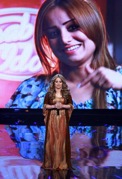 In this Friday, April 26, 2013 photo, Iraqi singer Barwas Hussein performs during the Arab Idol Show broadcast by MBC Arabic satellite channel, in Zouk Mosbeh neighborhood, north of Beirut, Lebanon. In her opening performance on the pan-Arab show, Barwas Hussein sang in Kurdish, but subsequently switched to Arabic and listed her country as Kurdistan, Iraq, after one of judges noted that the panel and the audience consider Kurdish provinces as integral parts of Iraq. (AP Photo/Bilal Hussein)