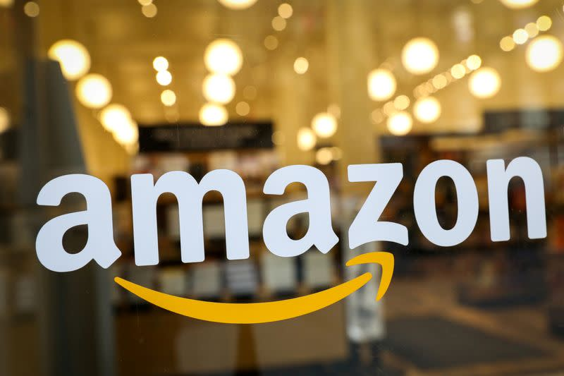 FILE PHOTO: The logo of Amazon is seen on the door of an Amazon Books retail store in New York