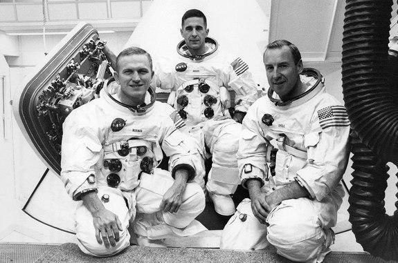 Apollo 8 crew members Frank Borman (left), Bill Anders and Jim Lovell, posing outside their command module in 1968.
