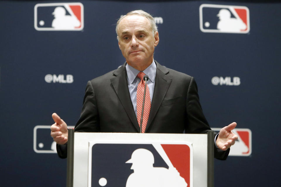 FILE - In this Nov. 21, 2019, file photo, baseball commissioner Rob Manfred speaks to the media at the owners meeting in Arlington, Texas. Its been over three months since the commissioners of major sports cancelled or postponed events because of the coronavirus. Enough time for us to grade them on how theyve handled the virus so far. (AP Photo/LM Otero, File)