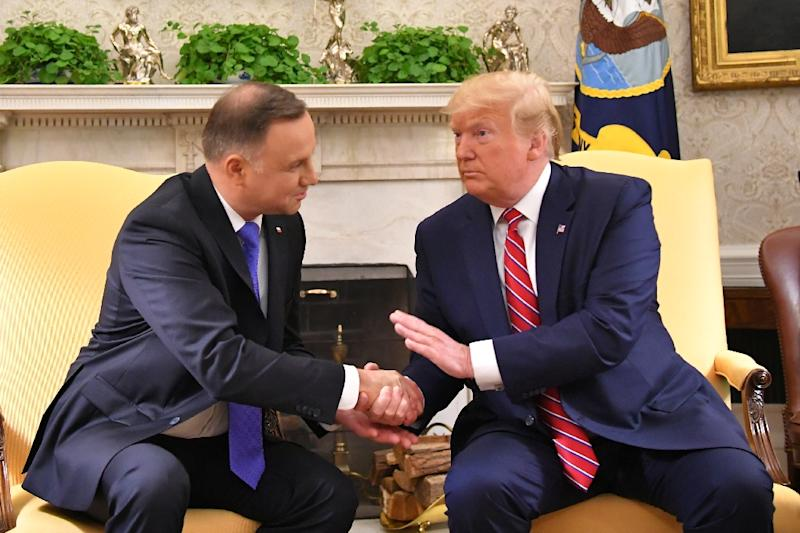 "Polish President Andrzej Duda has tried to charm his US counterpart Donald Trump, even touting the idea of building a ""Fort Trump"" to house thousands of US soldiers (AFP Photo/MANDEL NGAN)"