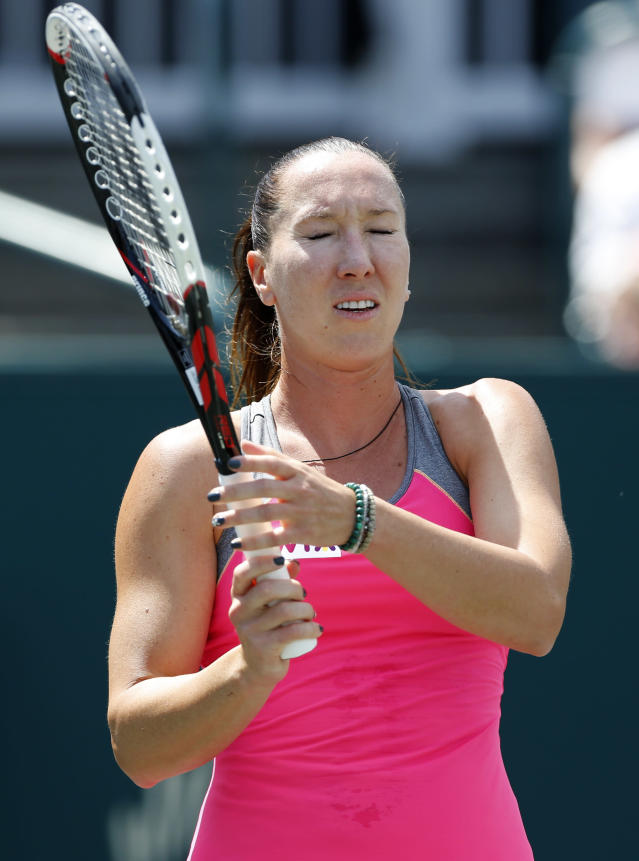 Jelena Jankovic, of Serbia, reacts during her match against Eugenie Bouchard, of Canada, at the Family Circle Cup tennis tournament in Charleston, S.C., Friday, April 4, 2014. (AP Photo/Mic Smith)