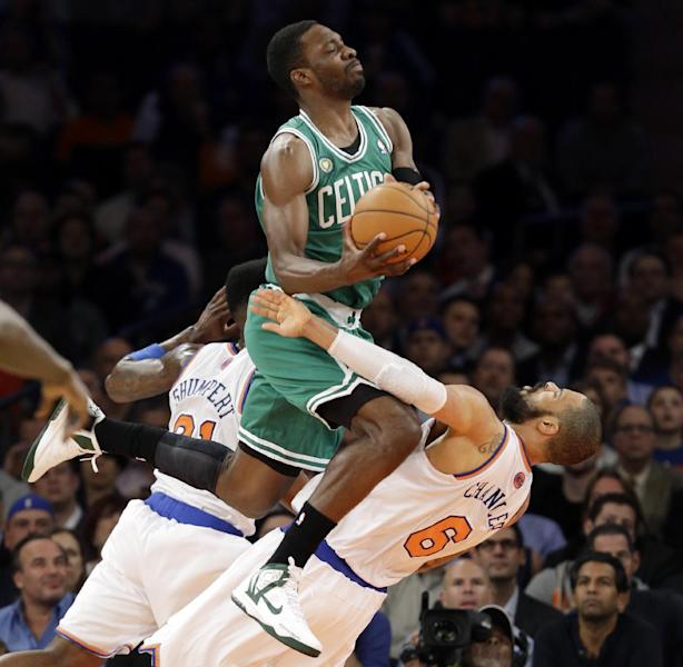 Boston Celtics forward Jeff Green (8) collides with New York Knicks center Tyson Chandler (6) in the first half of Game 5 of their first-round NBA basketball playoff series at Madison Square Garden in New York, Wednesday, May 1, 2013. (AP Photo/Kathy Willens)