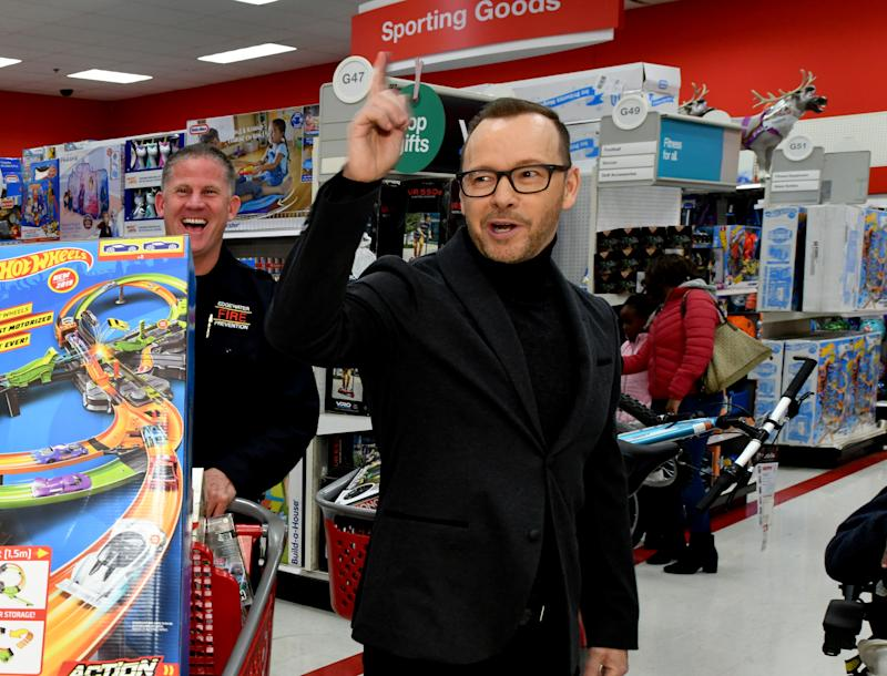 Donnie Wahlberg helps Target celebrate 10 years of its Heroes & Helpers program in Edgewater, N.J. This holiday season, Target will host nearly 400 of these events at stores nationwide, pairing first responders with kids to buy holiday gifts for their families. Since Heroes & Helpers began in 2009, Target has welcomed more than 100,000 kids and donated $5 million in grants to host these events. (Photo: Slaven Vlasic/Getty Images for Target)