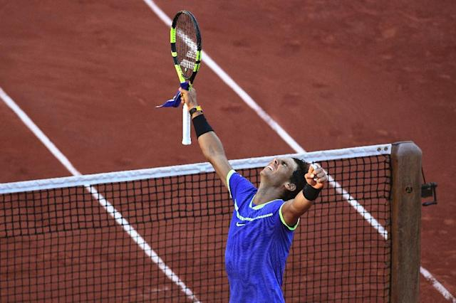 Spain's Rafael Nadal celebrates after winning his semifinal tennis match against Austria's Dominic Thiem at the Roland Garros 2017 French Open on June 9, 2017 in Paris (AFP Photo/FRANCOIS XAVIER MARIT)