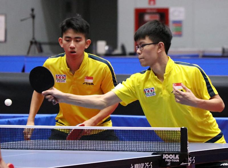 Koen Pang (left) and Josh Chua in action in the boys' doubles event at the ITTF World Junior Table Tennis Championships. (PHOTO: Singapore Table Tennis Association)