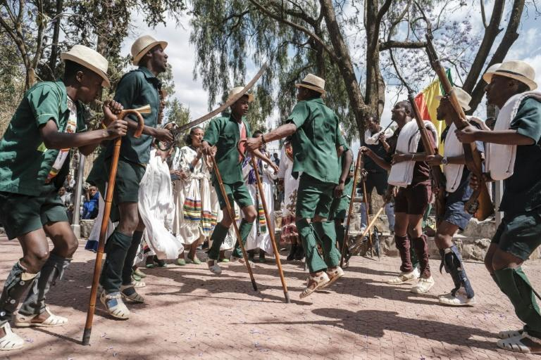 As rifle-toting actors danced around chanting actresses, an audience cheered when the troupe denounced the Tigray People's Liberation Front as a band of 'traitors'