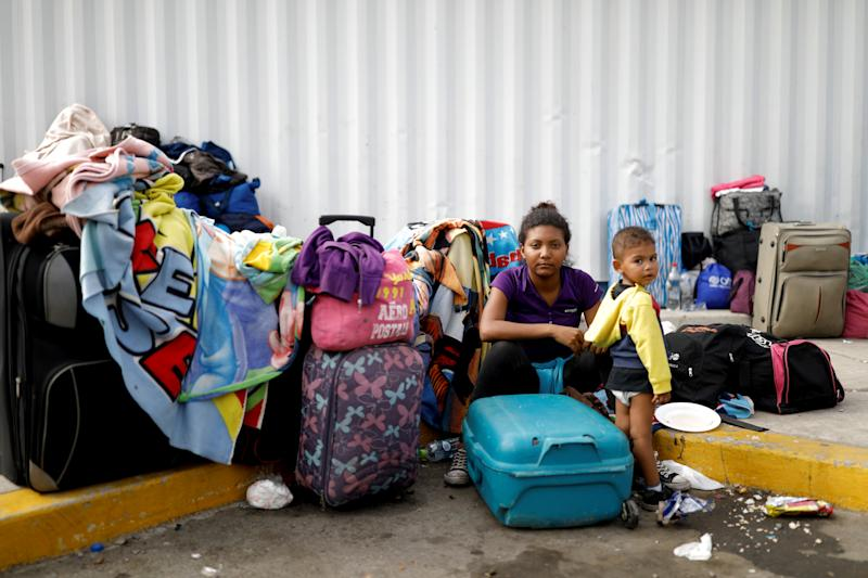 """Venezuelan migrant Juviamdy Garcia, 19, poses for a picture with her son Luian, 2, after having processed their documents at the Ecuadorian-Peruvian border service centre, before they continue their journey, on the outskirts of Tumbes, Peru, June 17, 2019. Garcia, a paramedic, is travelling with her son to reunite with her husband who has been living in Peru for a year. """"We arrived in San Antonio (in Venezuela) on Monday, and (the guide) helped us cross (the border) using the pathways. When we got to the other side, the Colombian police stopped us and made us return, we had to go back to the river, but that time just with the children, because nobody helped us to return."""" After a week travelling, """"I only have $20 left to get to where I'm going, because I have to go to Lima, but I don't know how far I can get,"""" Garcia said. """"My son has been sick; I had to take him to the doctor. He has been under treatment because he has amoebiasis; he had diarrhoea and blood in his stools."""" """"I want to be in my country, my dream is to be a doctor, I studied at the university, but I had to leave because I got pregnant and also because I had a terrible experience. I was in a classroom, and suddenly some men entered with guns, and they robbed us all, they (assaulted) a woman classmate and beat others."""" """"I said to my mother, I didn't want to go there anymore."""" REUTERS/Carlos Garcia Rawlins SEARCH """"MOTHERS REFUGEE"""" FOR THIS STORY. SEARCH """"WIDER IMAGE"""" FOR ALL STORIES."""
