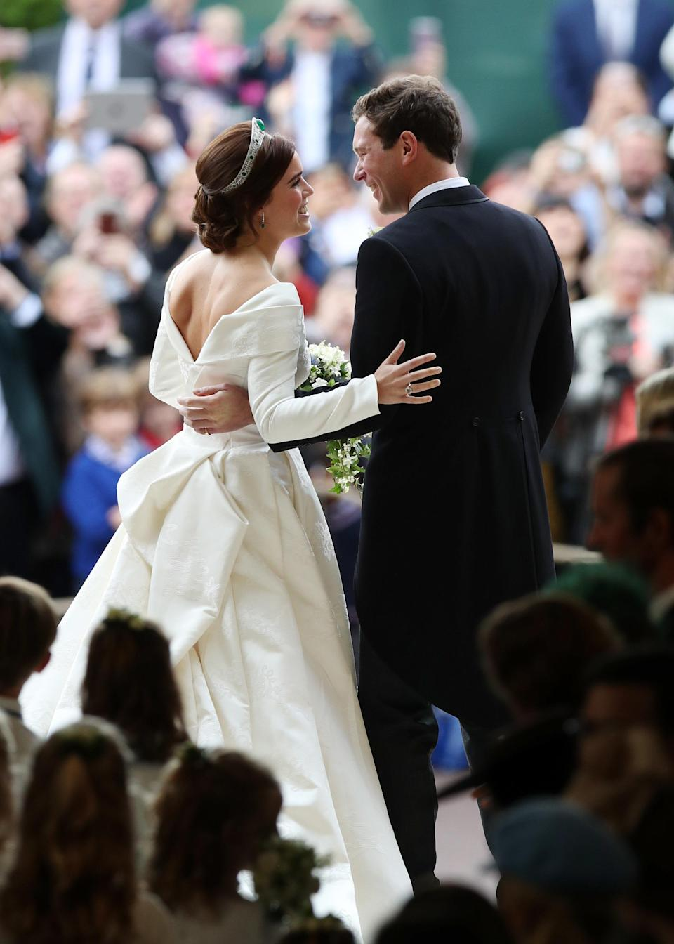 <p>Princess Eugenie and Jack Brooksbank tied the knot on October 12 and for the ceremony, the royal wore a surprisingly traditional gown by London Fashion Week designer Peter Pilotto. <em>[Photo: Getty]</em> </p>