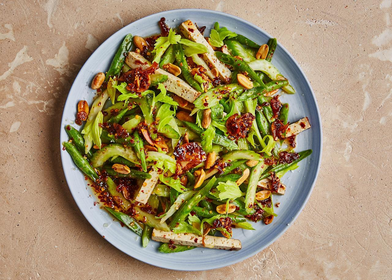 """If you have a batch of our <a href=""""https://www.bonappetit.com/recipe/chile-crisp?mbid=synd_yahoo_rss"""">Chile Crisp</a> at the ready, you can make this summery, no-fuss pantry salad in just 5 minutes. <a href=""""https://www.bonappetit.com/recipe/celery-green-bean-and-tofu-salad-with-chile-crisp?mbid=synd_yahoo_rss"""">See recipe.</a>"""