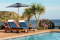 """<p>Heated to a warm 30C and complete with dreamy views across <a href=""""https://www.narehotel.co.uk/bookings/book"""" rel=""""nofollow noopener"""" target=""""_blank"""" data-ylk=""""slk:The Nare"""" class=""""link rapid-noclick-resp"""">The Nare</a>'s colourful gardens, over Cornwall's Carne Beach and out to sea, you'll love this outdoor swimming pool. </p><p>There's also an outdoor hot tub sitting under shelter overlooking the bay. This is a balmier 36C, so you can head here later and watch the sun go down with a glass of Champagne in hand.</p><p>For a hotel that offers genuine seclusion and a sanctuary far from the crowds while by the sea, this coastal address should be on your summer hit list.</p><p><a class=""""link rapid-noclick-resp"""" href=""""https://www.narehotel.co.uk/bookings/book"""" rel=""""nofollow noopener"""" target=""""_blank"""" data-ylk=""""slk:BOOK NOW"""">BOOK NOW</a> </p>"""