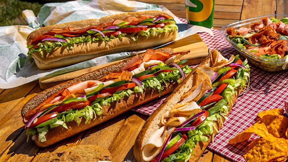 Three different types of Subway sandwiches.