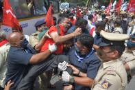 Police personnel detain an activist from a farmers rights organisation during a protest following the recent passing of agriculture bills in the Lok Sabha (lower house), in Bangalore on September 25, 2020. - Angry farmers took to the streets and blocked roads and railways across India on September 25, intensifying protests over major new farming legislation they say will benefit only big corporates. (Photo by Manjunath Kiran / AFP) (Photo by MANJUNATH KIRAN/AFP via Getty Images)