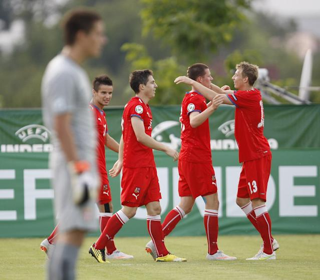 Czech's players celebrate after scoring against Serbia during their final football match of the UEFA European Under-19 Championship 2010/2011 in Mogosoaia village, next to Bucharest, on July 29, 2011. AFP PHOTO / STRINGER (Photo credit should read STRINGER/AFP/Getty Images)