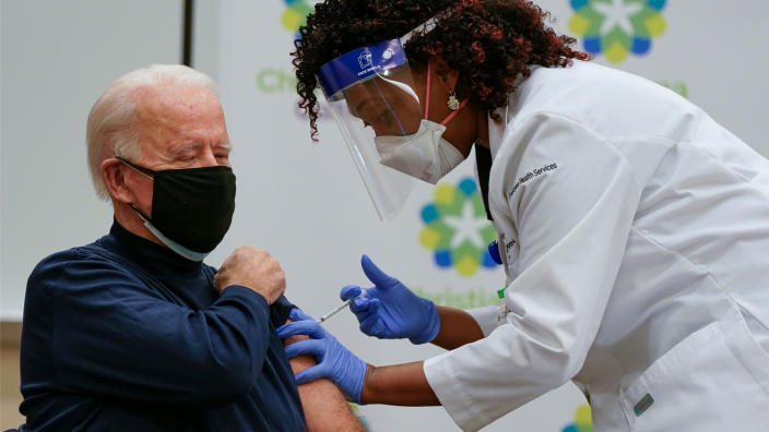 US President-elect Joe Biden receives a Covid-19 vaccination from Tabe Masa, Nurse Practitioner and Head of Employee Health Services, at the Christiana Care campus in Newark, Delaware on December 21, 2020. (Alex Edelman/AFP via Getty Images)