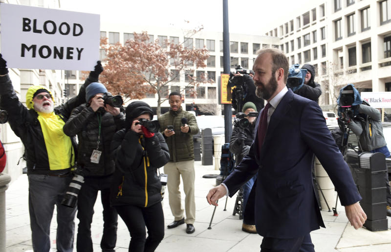 Rick Gates arrives at federal court in Washington, Friday, Feb. 23, 2018. Gates, a former top adviser to President Donald Trump's campaign is scheduled to plead guilty in the special counsel's Russia investigation to federal conspiracy and false statements charges. (AP Photo/Susan Walsh)