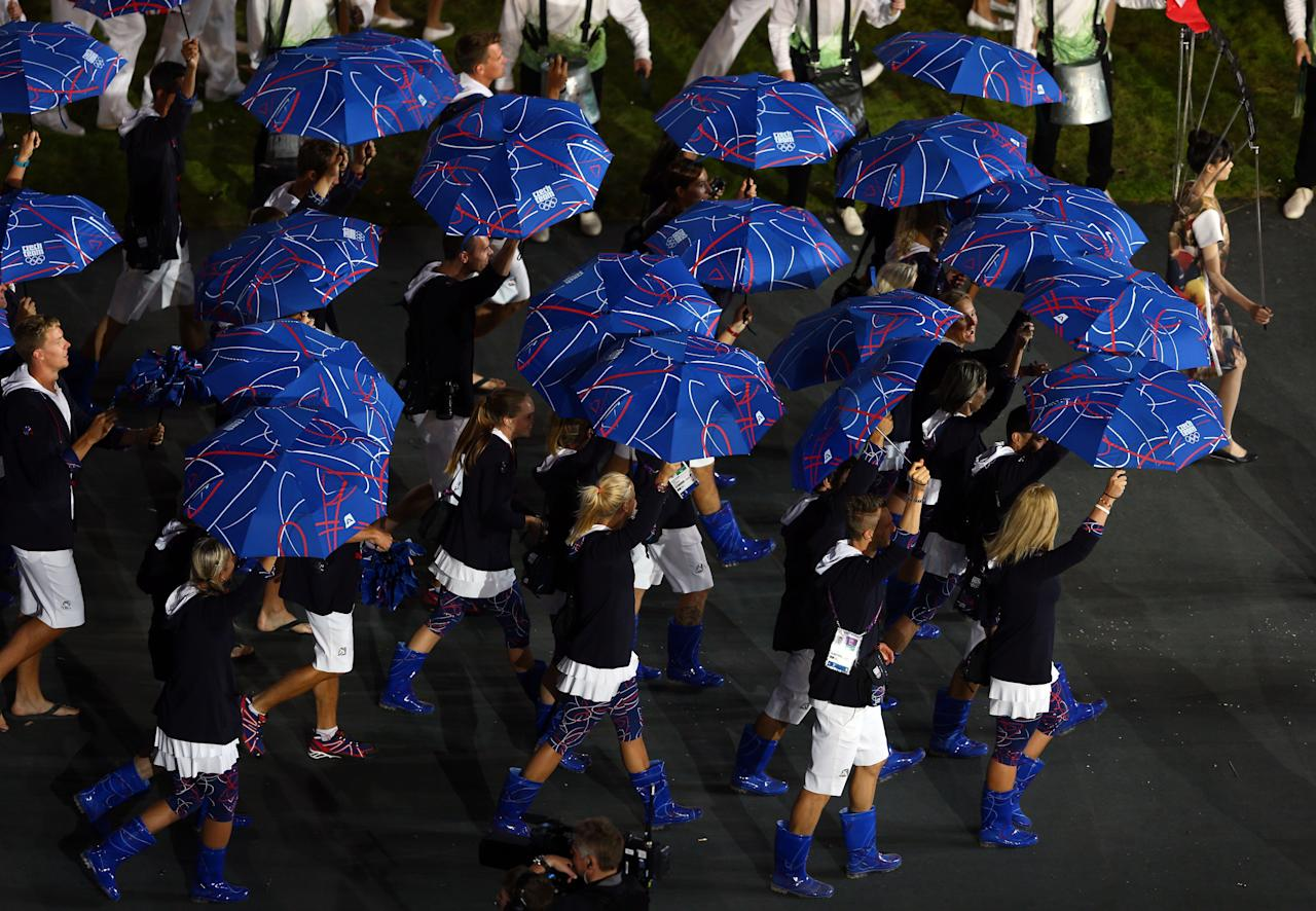 LONDON, ENGLAND - JULY 27: The Czech Republic delegation wearing rubber boots and umbrellas enter the stadium during the Opening Ceremony of the London 2012 Olympic Games at the Olympic Stadium on July 27, 2012 in London, England.  (Photo by Paul Gilham/Getty Images)