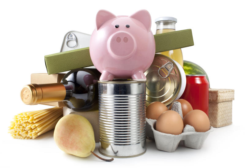 Groceries with piggy bank.