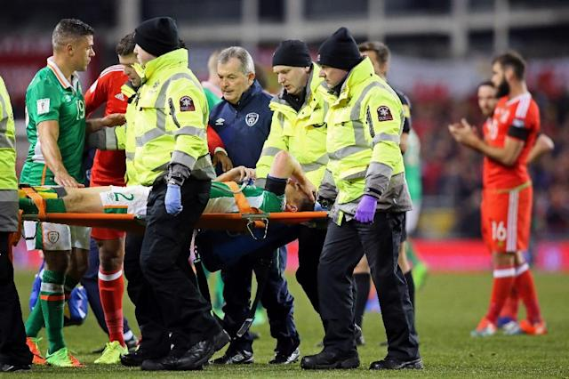 Republic of Ireland's defender Seamus Coleman is taken from the pitch on a stretcher after being injured during the World Cup 2018 qualification football match against Wales (AFP Photo/Paul FAITH)