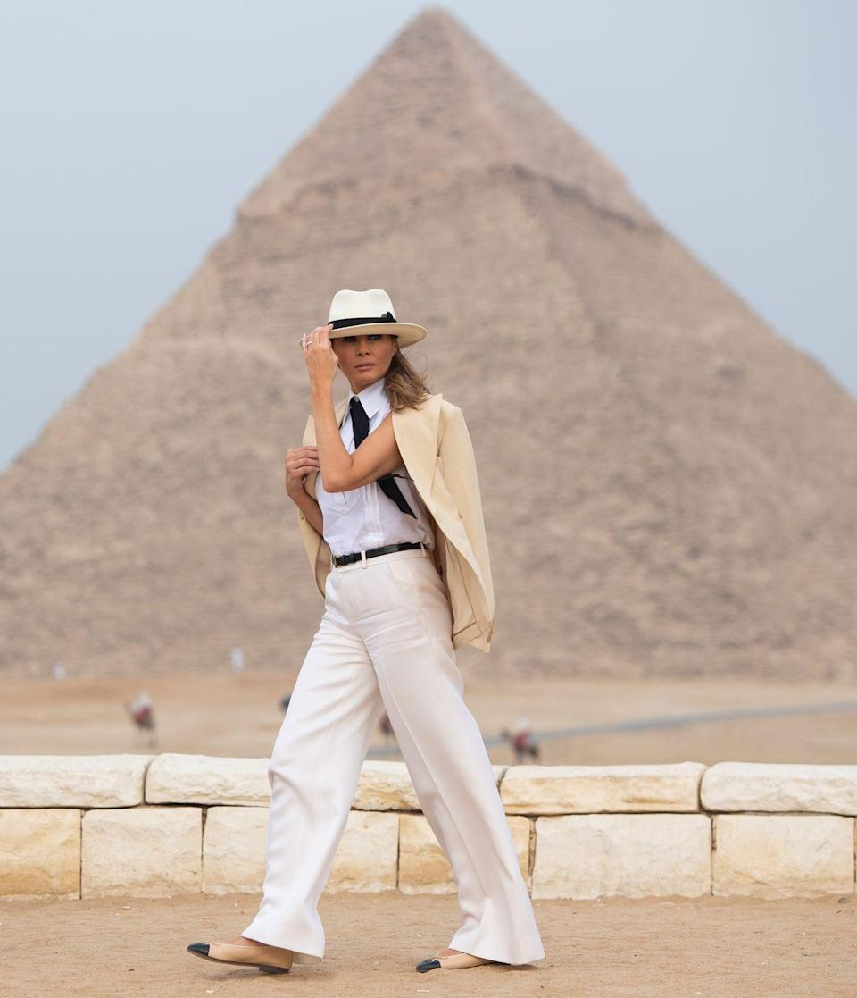<p>The former model has chosen some interesting fashion choices over the past four years, but this creamy outfit that she wore to the Giza Pyramids in Egypt is the most surprising. From the straw brimmed hat to the men's tie, it shows how far first lady fashion has truly come. </p>