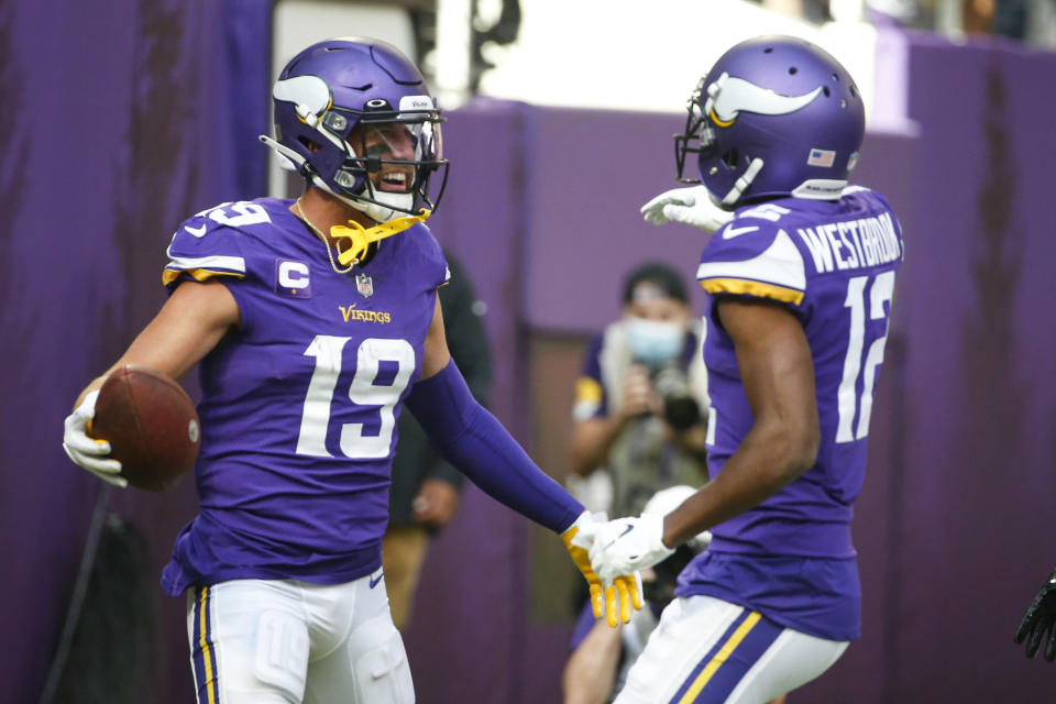 Minnesota Vikings wide receiver Adam Thielen (19) celebrates touchdown against the Seattle Seahawks with wide receiver Dede Westbrook (12) in the first half of an NFL football game in Minneapolis, Sunday, Sept. 26, 2021. (AP Photo/Bruce Kluckhohn)