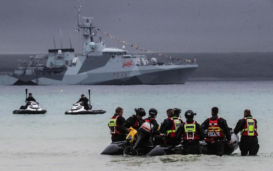 The Royal Navy shows off its defences around the summit, with inflatable boats, jet skis and warships on patrol