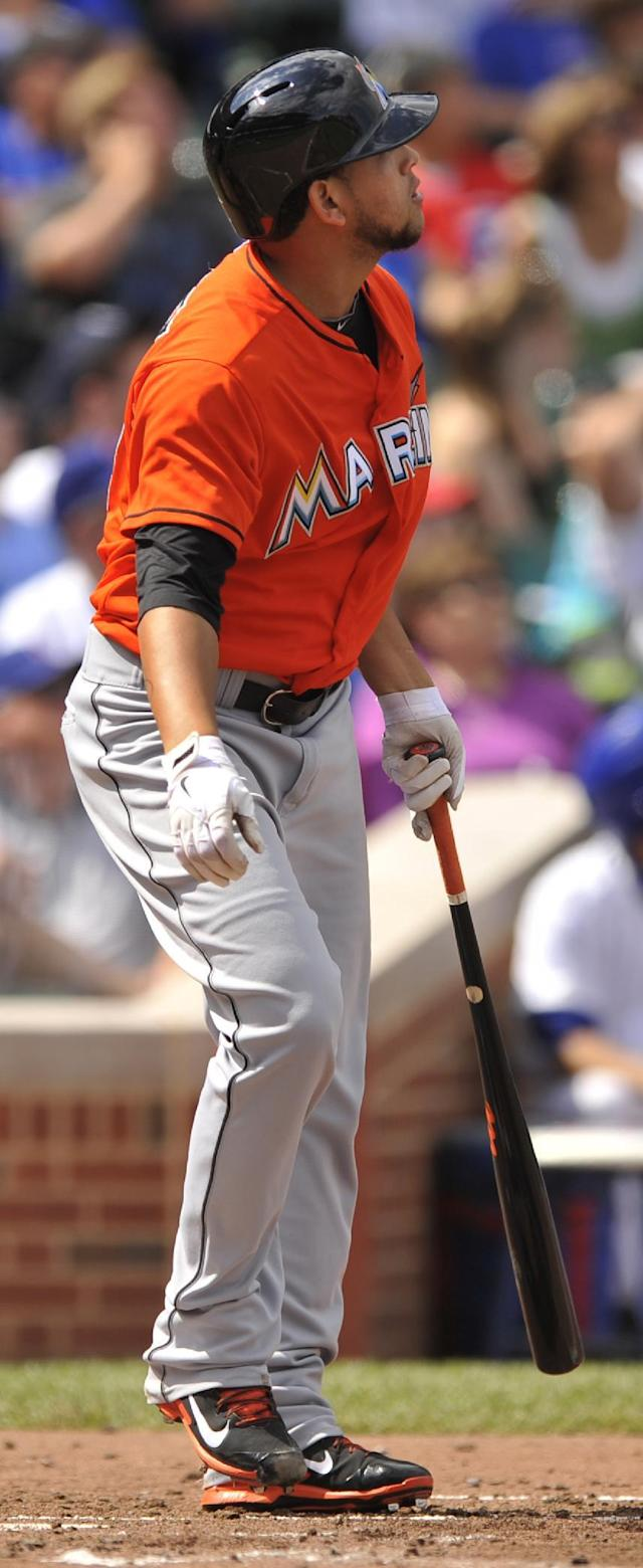 Miami Marlins' Henderson Alvarez watches his three-run home run during the second inning of a baseball game against the Chicago Cubs in Chicago, Monday, Sept. 2, 2013. (AP Photo/Paul Beaty)