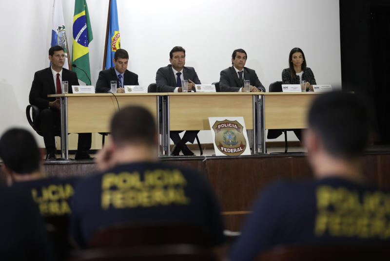 Authorities hold a press conference regarding the investigation into kickbacks and money laundering that they say involve Paraguay's ex-President Horacio Cartes, at Federal Police headquarters, in Rio de Janeiro, Brazil, Tuesday, Nov. 19, 2019. Brazilian police are seeking the arrest of the former president as part of the investigation. (AP Photo/Silvia Izquierdo)