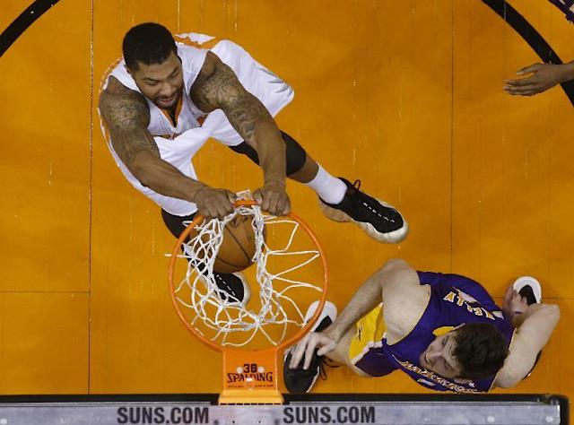Phoenix Suns forward Markieff Morris dunks against Los Angeles Lakers forward Ryan Kelly during an NBA basketball game Wednesday, Jan. 15, 2014, in Phoenix. (AP Photo/The Arizona Republic, Michael Chow)