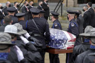 """Pallbearers from the U.S. Capitol Police, center, carry the casket of William """"Billy"""" Evans into St. Stanislaus Kostka Church before a funeral Mass, Thursday, April 15, 2021, in Adams, Mass. Evans, a member of the U.S. Capitol Police, was killed on Friday, April 2, when a driver slammed his car into a checkpoint he was guarding at the Capitol. (AP Photo/Steven Senne)"""
