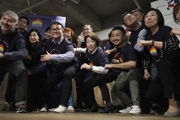Tokyo 2020 Organizing Committee President Seiko Hashimoto, center, poses for a photo with representatives and staff at Pride House Tokyo Legacy during her visit to the house, in Tokyo Tuesday, April 27, 2021. Japan marked LGBTQ week with pledge to push for equality law before the Olympics. (AP Photo/Eugene Hoshiko, Pool)