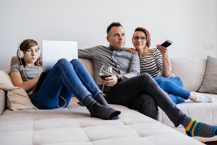 "<span class=""caption"">More people turn to alcohol in the wake of disasters, research has found.</span> <span class=""attribution""><a class=""link rapid-noclick-resp"" href=""https://www.gettyimages.com/detail/photo/family-relaxing-on-sofa-at-home-royalty-free-image/1217703099?adppopup=true"" rel=""nofollow noopener"" target=""_blank"" data-ylk=""slk:Kerkez/GettyImages"">Kerkez/GettyImages</a></span>"