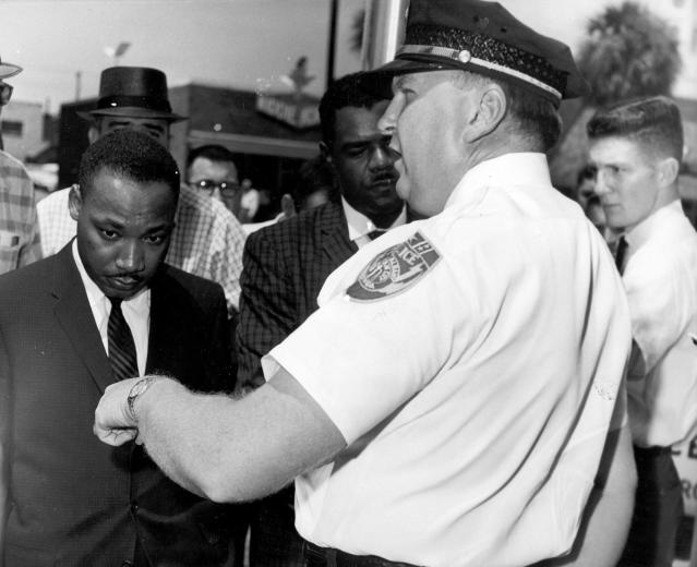 <p>During months of local anti-segregation campaigns led by the SCLC in Albany, Georgia, Reverend Dr. Martin Luther King Jr. is arrested by Albany's Chief of Police, Laurie Pritchett, after praying at City Hall, on July 27, 1962. (AP Photo) </p>