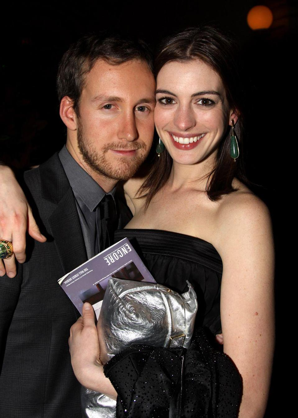"""<p>The couple were <a href=""""https://www.bustle.com/articles/126326-how-did-anne-hathaway-and-adam-shulman-first-meet-their-story-is-pretty-close-to-love"""" rel=""""nofollow noopener"""" target=""""_blank"""" data-ylk=""""slk:introduced"""" class=""""link rapid-noclick-resp"""">introduced</a> by a mutual friend at the Palm Springs Film Festival in 2008. The two have been married since 2012 and have a son together, so I guess you could say things worked out nicely. Though Hathaway has said she only married Shulman because she """"<a href=""""https://people.com/movies/anne-hathaway-jokes-that-she-only-married-adam-shulman-because-she-couldnt-get-emily-blunt/"""" rel=""""nofollow noopener"""" target=""""_blank"""" data-ylk=""""slk:couldn't get Emily"""" class=""""link rapid-noclick-resp"""">couldn't get Emily</a> [Blunt].""""</p>"""