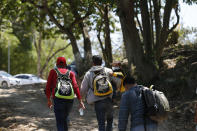 Migrants walk into Mexico after crossing the Usumacinta River from Guatemala, in Frontera Corozal, Chiapas state, Mexico, Wednesday, March 24, 2021. (AP Photo/Eduardo Verdugo)