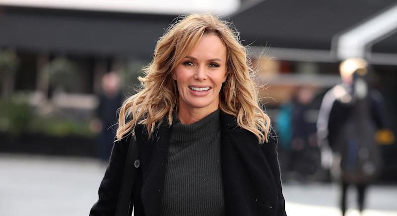 Amanda Holden has wowed fans with a family snap of daughters - and they can't believe how identical they look to her [Image: Getty]
