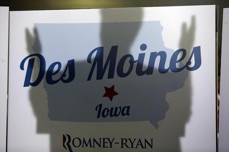 The shadow of Republican presidential candidate and former Massachusetts Gov. Mitt Romney is cast on a Des Moines sign as he campaigns at Iowa Events Center, in Des Moines, Iowa, Sunday, Nov. 4, 2012. (AP Photo/Charles Dharapak)