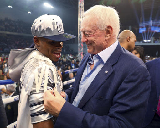 Errol Spence Jr. is congratulated by Dallas Cowboys owner Jerry Jones after Spence's victory over Carlos Ocampo in the first round of an IBF welterweight title boxing match Saturday, June 16, 2018, in Frisco, Texas. (AP Photo/Richard W. Rodriguez)